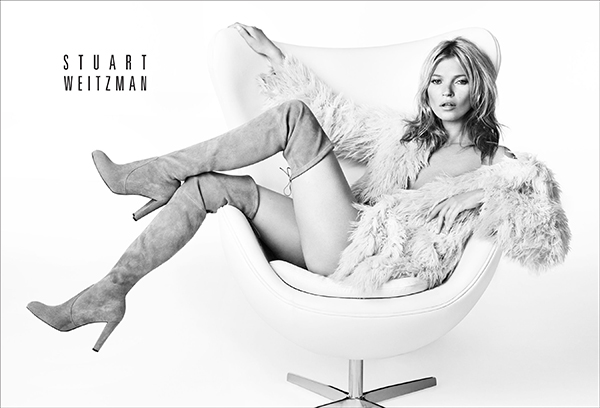 Kate Moss lounges in Stuart Weitzman boots.